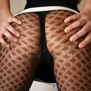 Kaleys ass looks amazing in these black mesh stockings that go all the way up around her perfect round ass. Be sure to check out the pics of her grabbing her ass!