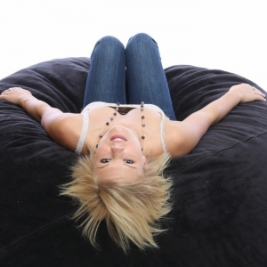 Petite blonde on a bean bag